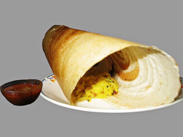 masala dosa and curry on gray background