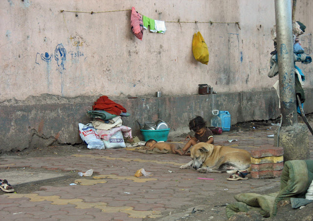 homeless child on pavement