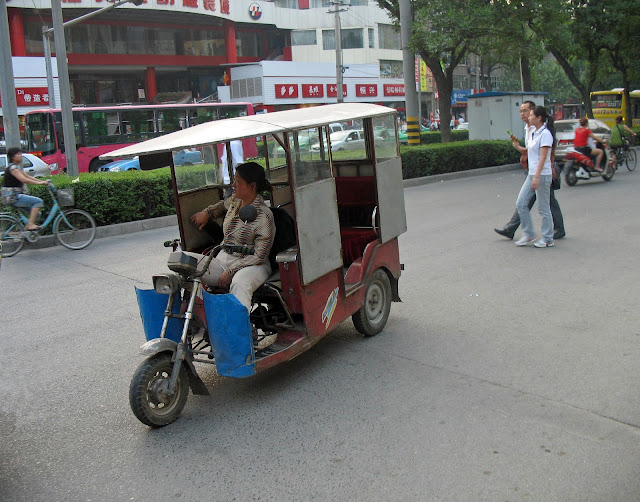 woman rickshaw driver in China