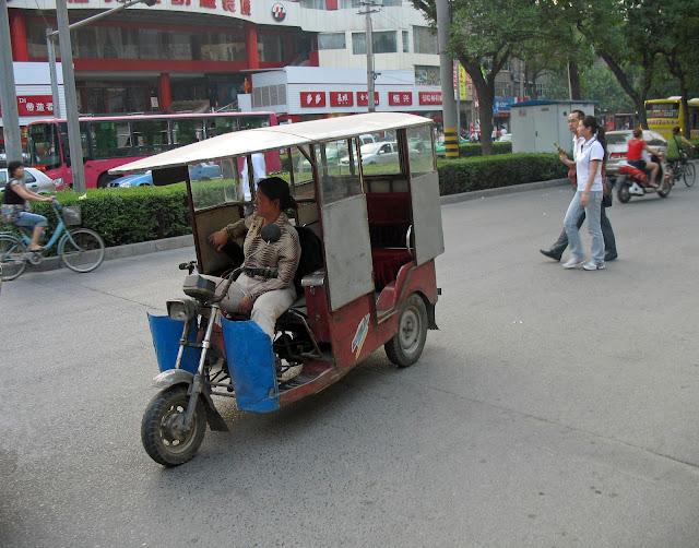 woman rickshaw driver in China