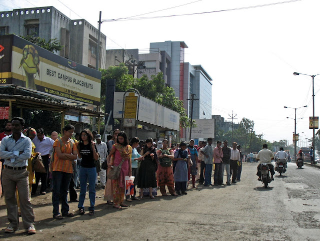 crowd of people at bus-stop