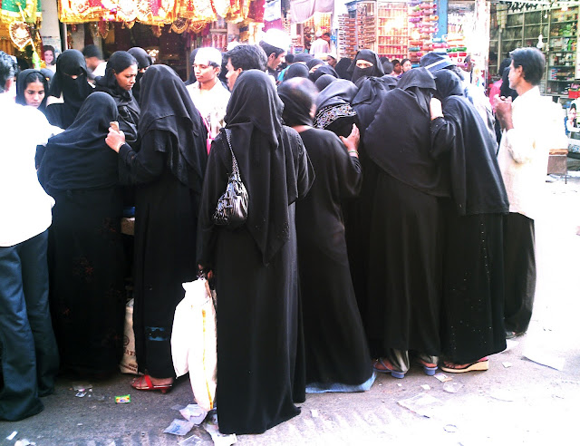 group of burkha clad women in market