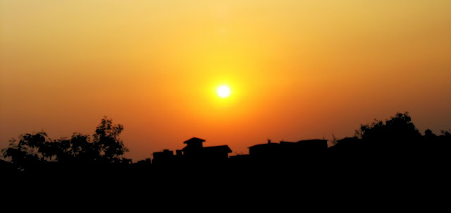 sunset with houses silhouetted