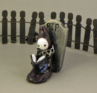 Poppet reads The Graveyard Book