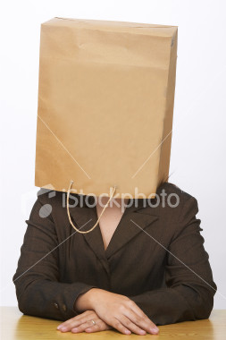 woman with bag over face