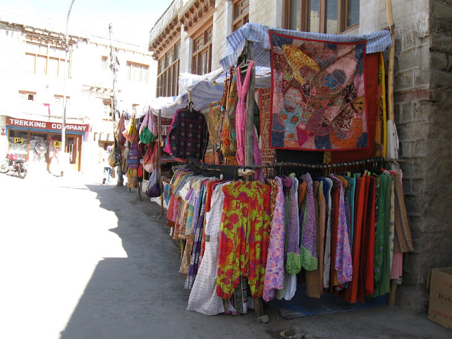 Colourful clothes and rugs for sale