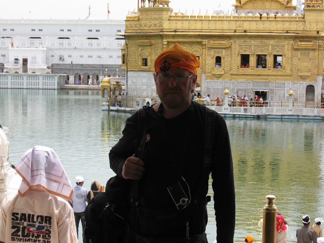 Heads covered , we visit the Golden Temple in Amritsar.