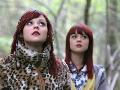 Kathryn and Megan Prescott as, respectively, Emily and Katie Fitch