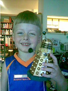 Boy with his Dalek toy