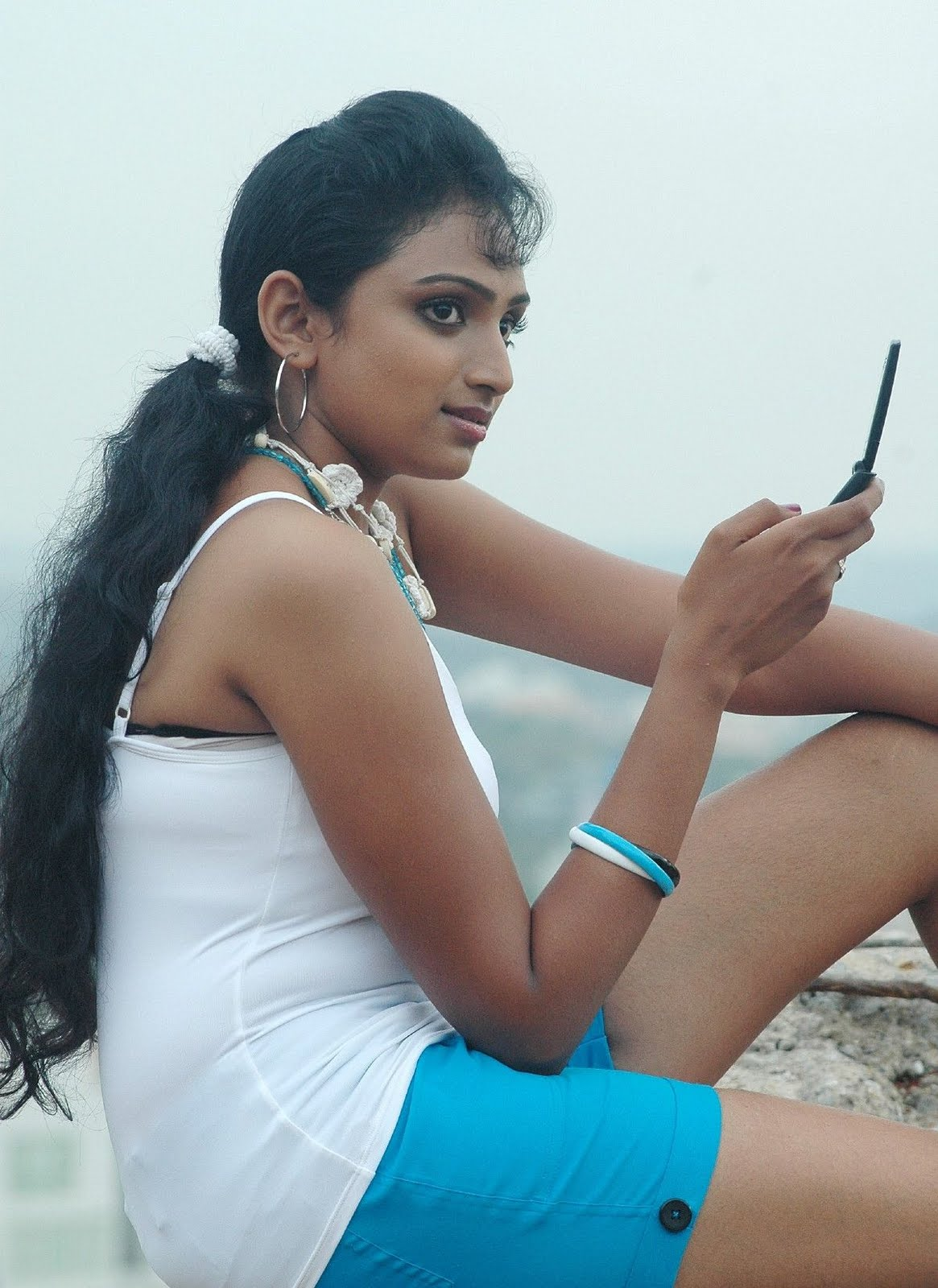 waheeda spicy in white shorts in thakita thakita photo gallery