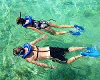 snorkling, snorkeling