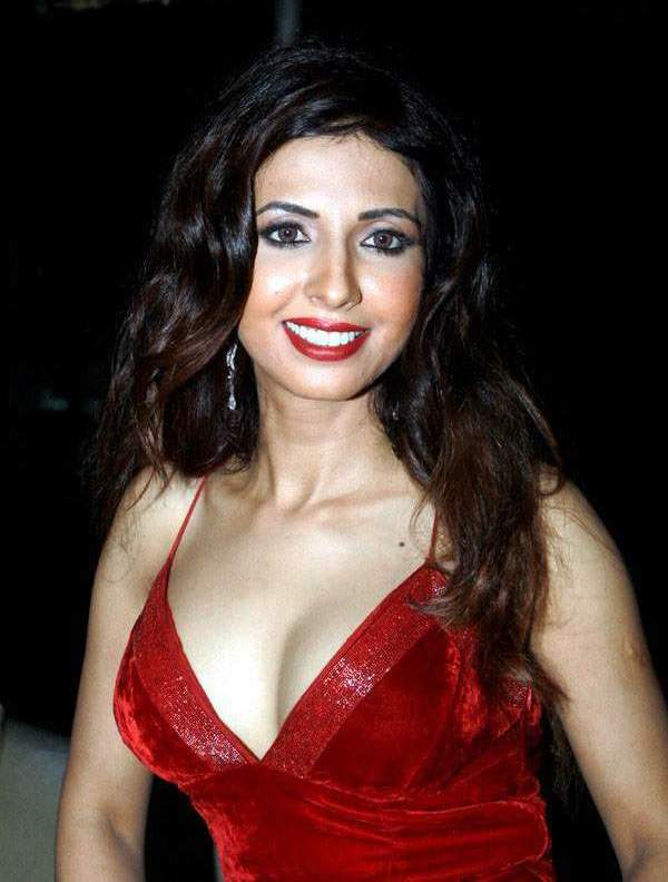 Mallika Movie hot actress Sheena Nayar looking dam sexy in Red tight outfit