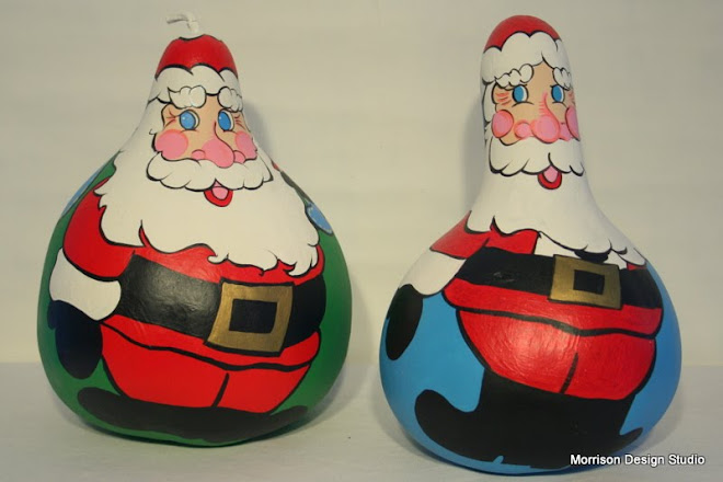 Large Santa Gourds, with their toy bag over their shoulder.