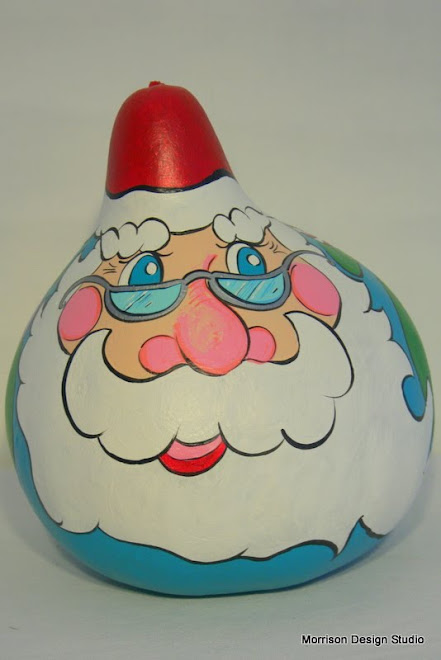 Santa Gourd - peeking into his toy bag over his shoulder.
