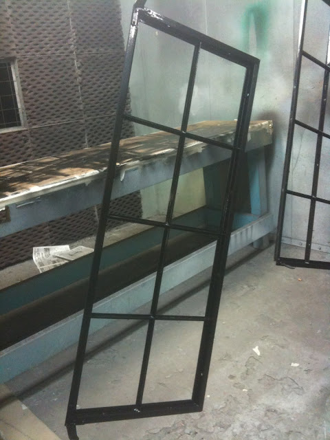 steel casement window frame being painted