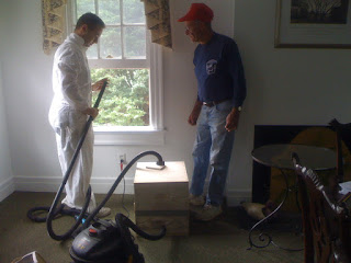 Rob and Sherrill getting the bee-vac ready