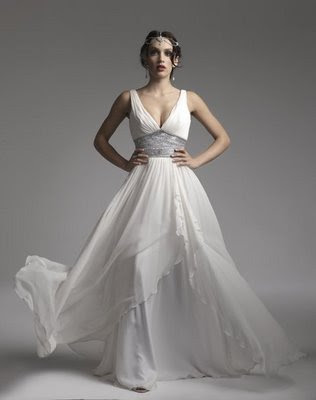 I want a soft dreamy and flowy wedding gown with a sheer touch of romance
