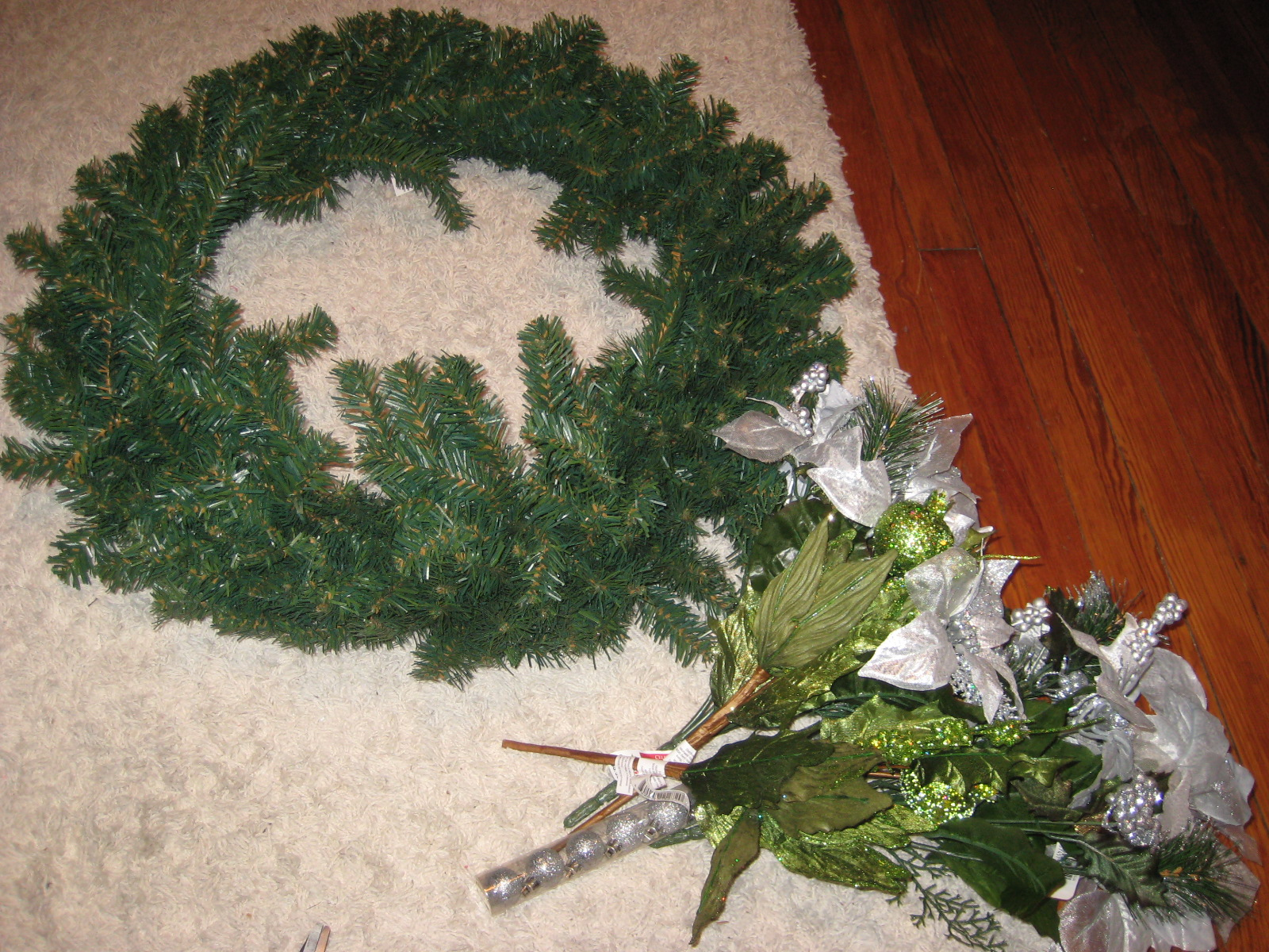 For all things creative diy christmas wreath first cut all your flowers off the bunch and put in a pile 2 cut off a good length of green florist wire and wrap it around the base of your mightylinksfo