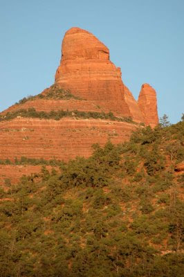 a red-rock mountain towers over the Sedona valley