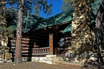 our historical cabin, nestled in the woods near the canyon rim