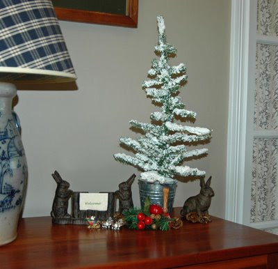 rabbit greeters and a snowy tree stand watch near the front door