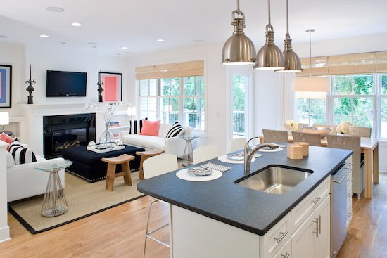 Room A Kitchen With Three Metal Pendant Lights And A Dining Room With
