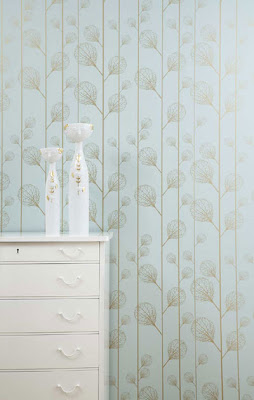 Turquoise wallpaper with gold plants from Ferm Living