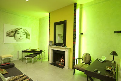 Built in mood lighting surrounds a fireplace in a London flat