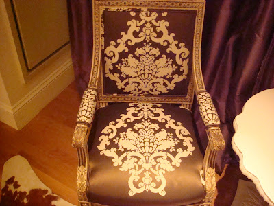 Close up of an Upholstered antique chair inSilk Trading Co. Fuscari damask fabric in Truffle Cream in a sitting area in a NYC loft