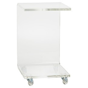 Lucite side table on wheels from cb2