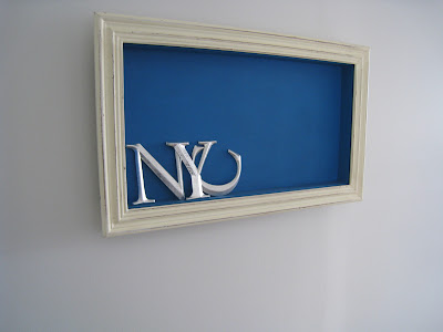 Shadow box made by Shannon Cockrell hung on a wall in her London flat