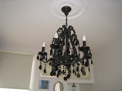 Black chandelier in a small London kitchen