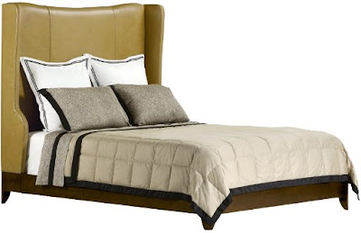 Wood bed frame with winged green leather headboard from Baker Furniture