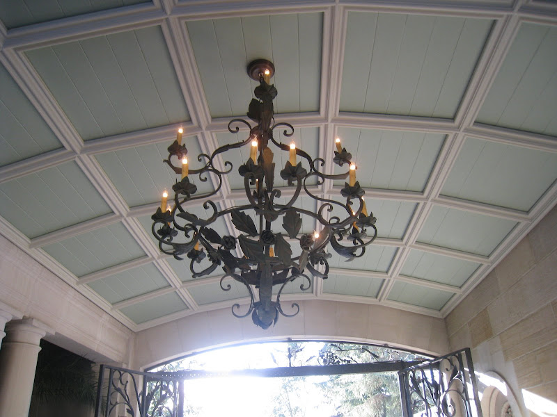 Wrought iron scroll work chandelier in the covered entry to the Greystone Estate