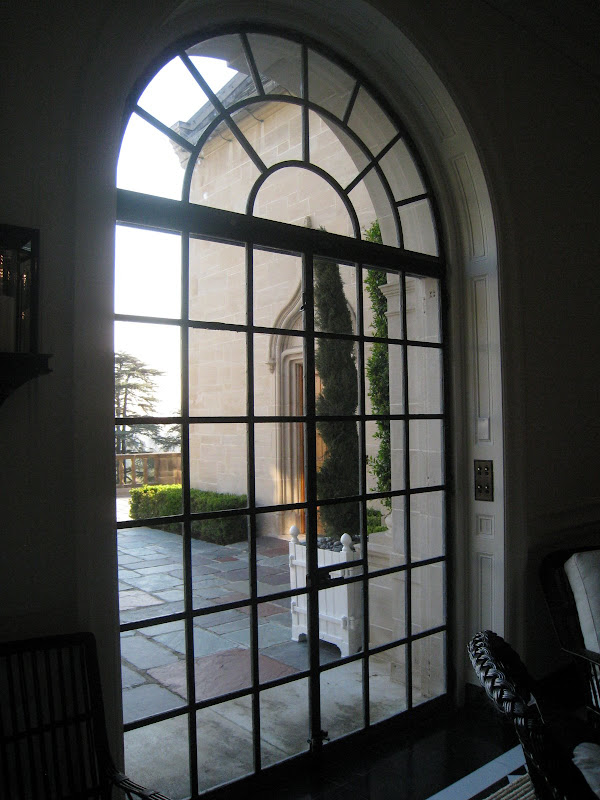 Large multi-paned leaded glass windows and doors in the Greystone mansion