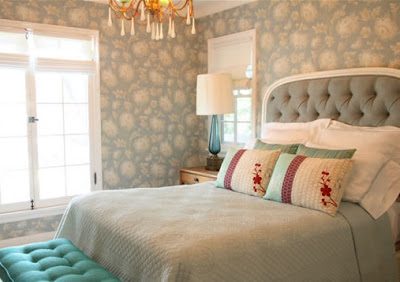 Guest bedroom with Robin's Egg Blue Chrysanthemum wallpaper, light blue tufted headboard, blue bedding and a tufted bench