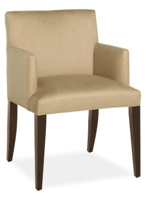 Cognac colored upholstered tight back and seat arm chair from Room & Board