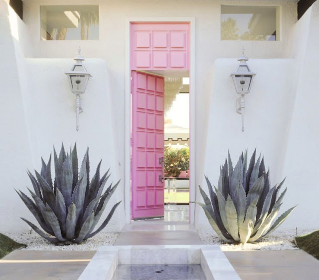 Pink raised panel front door at a Palm Springs home