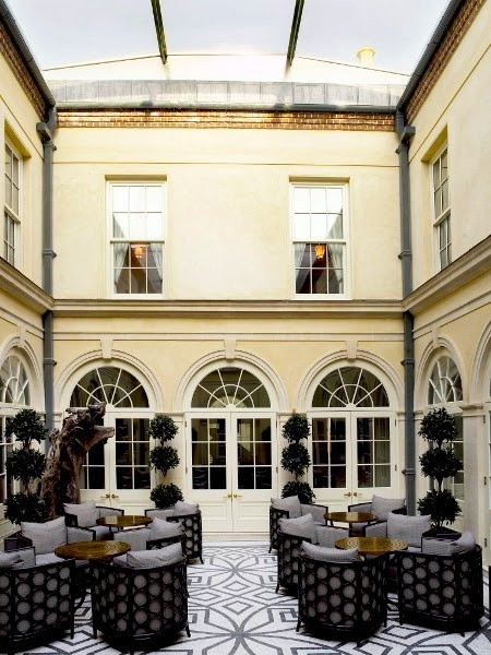 Courtyard at the Lime Wood Hotel with Regency style architecture and a mosaic floor