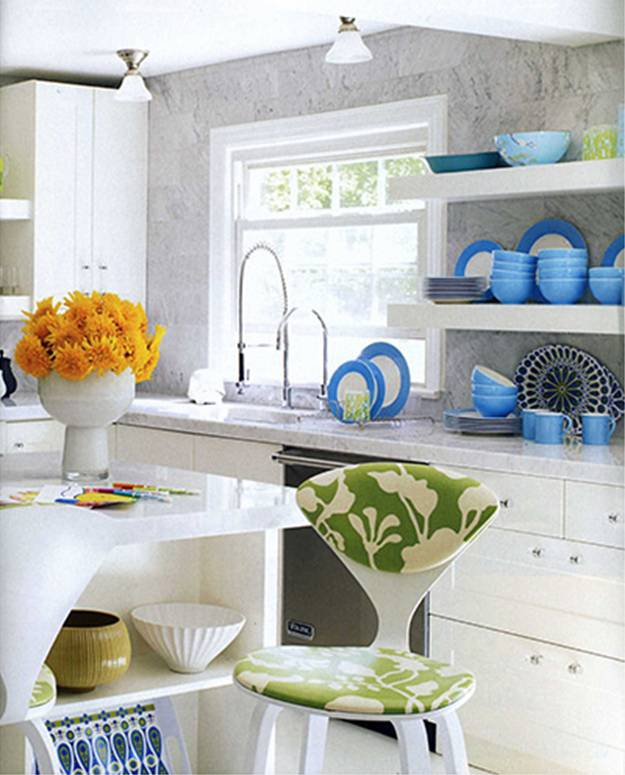 Kitchen by  Jonathan Adler with marble countertops, to the ceiling marble backsplash and turquoise dishes on open shelves