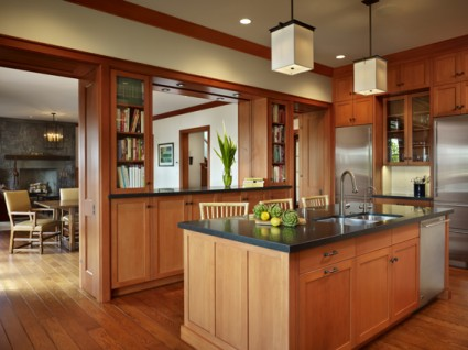 Wood paneled kitchen with wood cabinets with square recessed panel doors