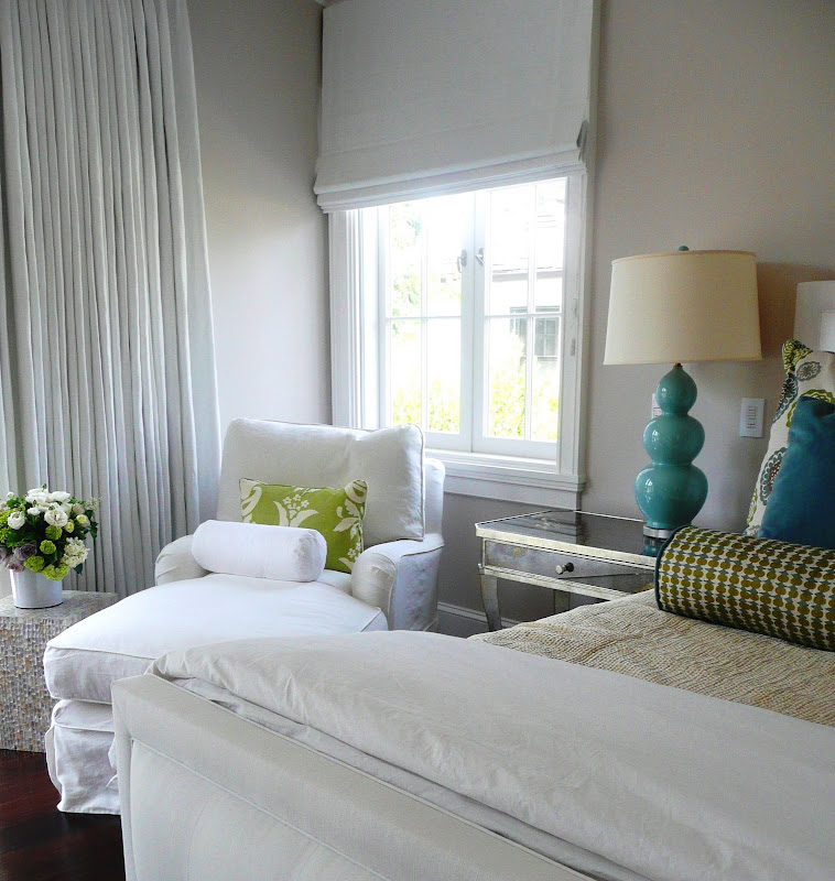 bedroom by brooke giannetti with a white chaise lounge mirrored