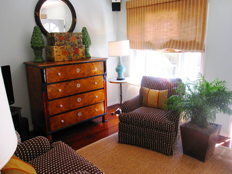 Sea foam living room with dueling brown armchairs with white polkadots