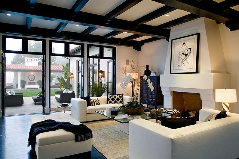 Spanish Revival Furniture Living room in a Spanish revival home with exposed painted black beams ...