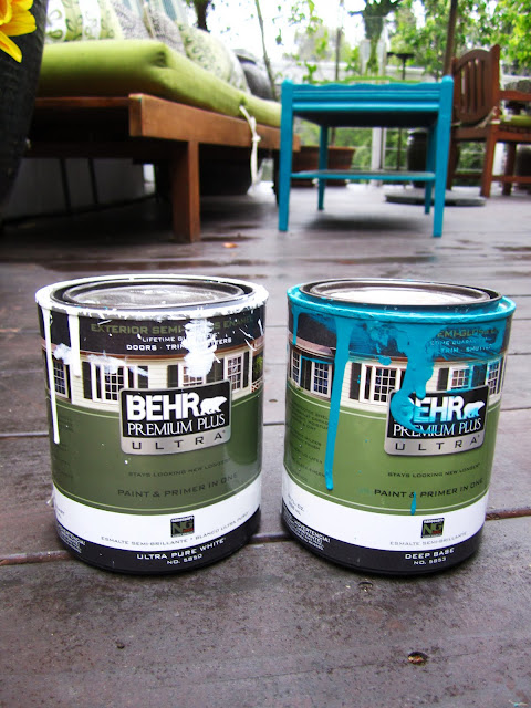 Cans of Behr Paint in Tropical Waters and White
