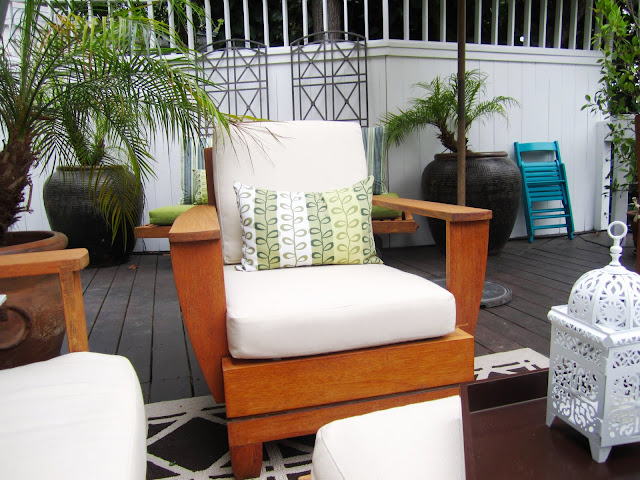 Teak armchair with off white sunbrella cushions