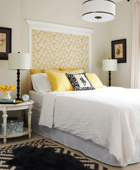 Master bedroom with black, white and yellow wall mounted &quot;headboard&quot; made of floral wallpaper and left over crown molding