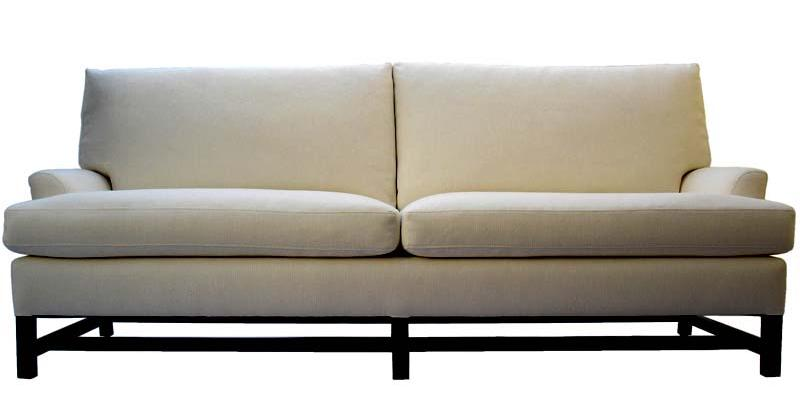 White sofa with black exposed legs from Plush Home