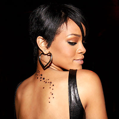 Here's an example picture of Rihanna's tattoo. star tattoo in her ear