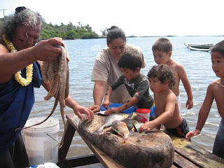 Uncle Leimana and keikis with fish from fispond